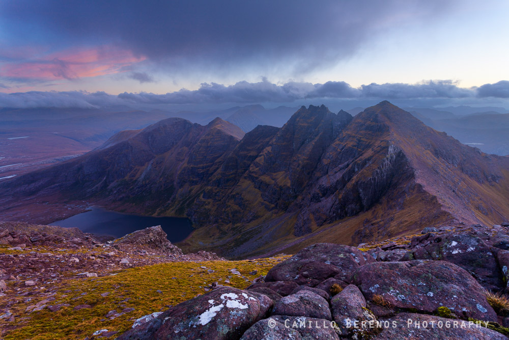 This is just another take of the classic view over the impressive ridge of Sgurr Fiona and An Teallach. Unfortunately the cloud cover prevented an explosion of colours at sunset, but visibility remained decent, so no complaining from me. I would have loved to get lower to emphasize the sandstone rocks a little more, but this would have concealed Loch Toll an Lochain.