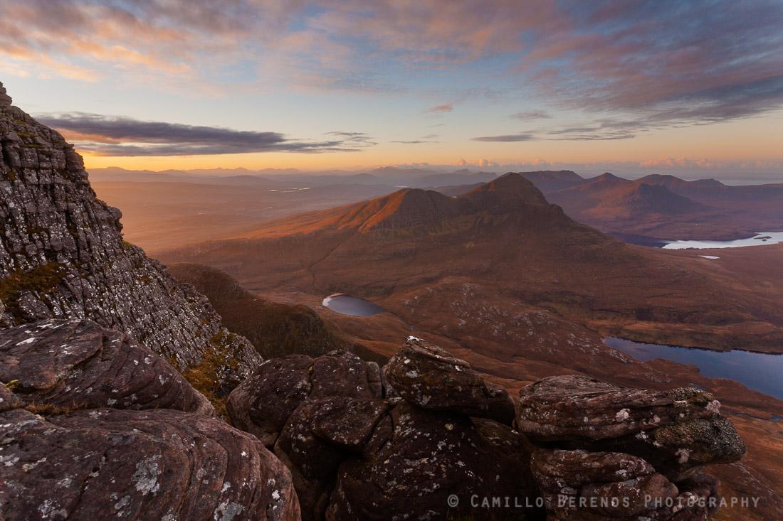 Cul Beag in the warm first light of the morning. The little lochan just below Cul Beag is Lochan Dearg, while Beinn an Eoin can be seen behind the larger loch behind Cul Beag (Loch Lurgainn).