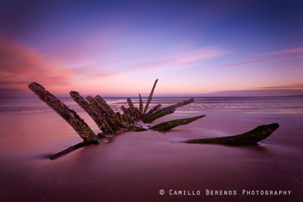 Shipwreck at low tide on Longniddry beach.