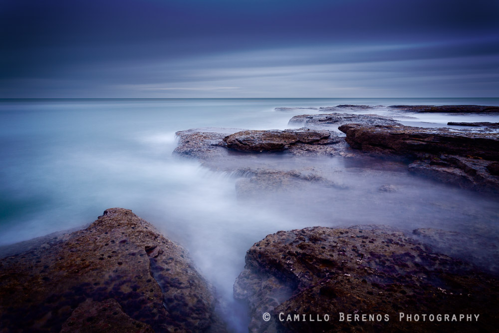 Blue hour before sunrise at a beach near Dunbar, on the East Lothian coast. The long exposure has given the sea this silky appearance, hiding that the waves were actually quite impressive.