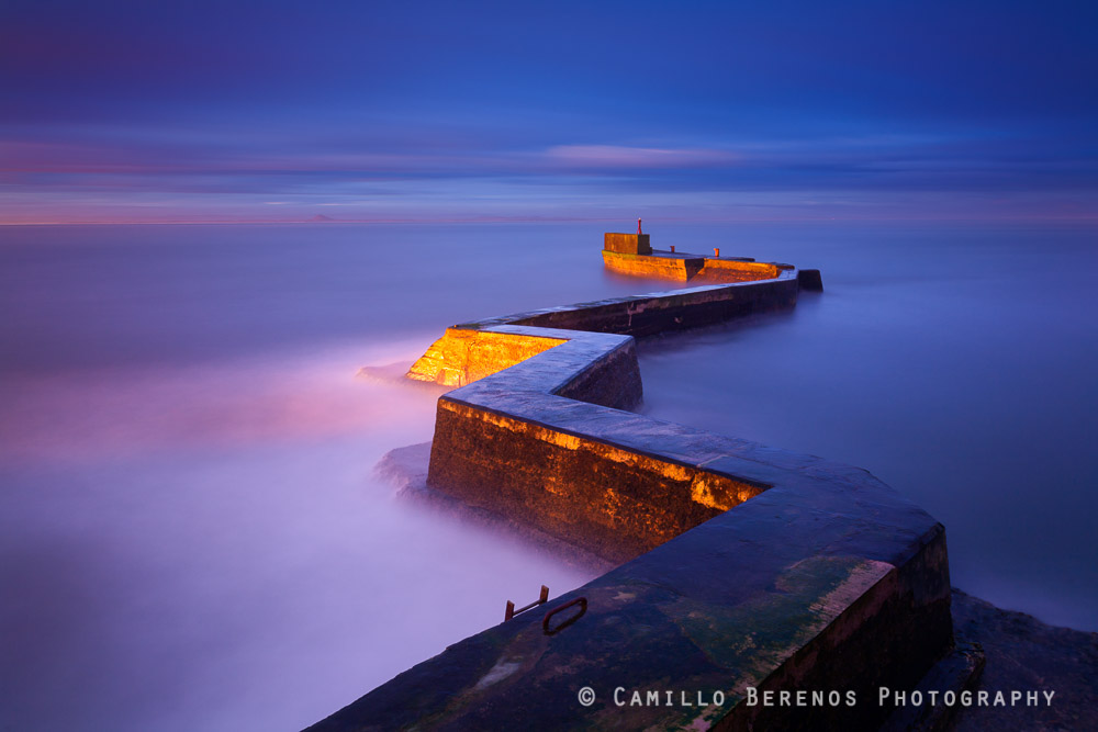 The sun rose perpendicular to the zigzag, leading to wonderfully soft directional light on the breakwater behind the St Monans harbour.