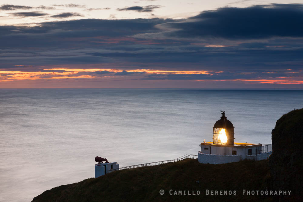 The lighthouse at St Abbs head during the blue hour at dawn.