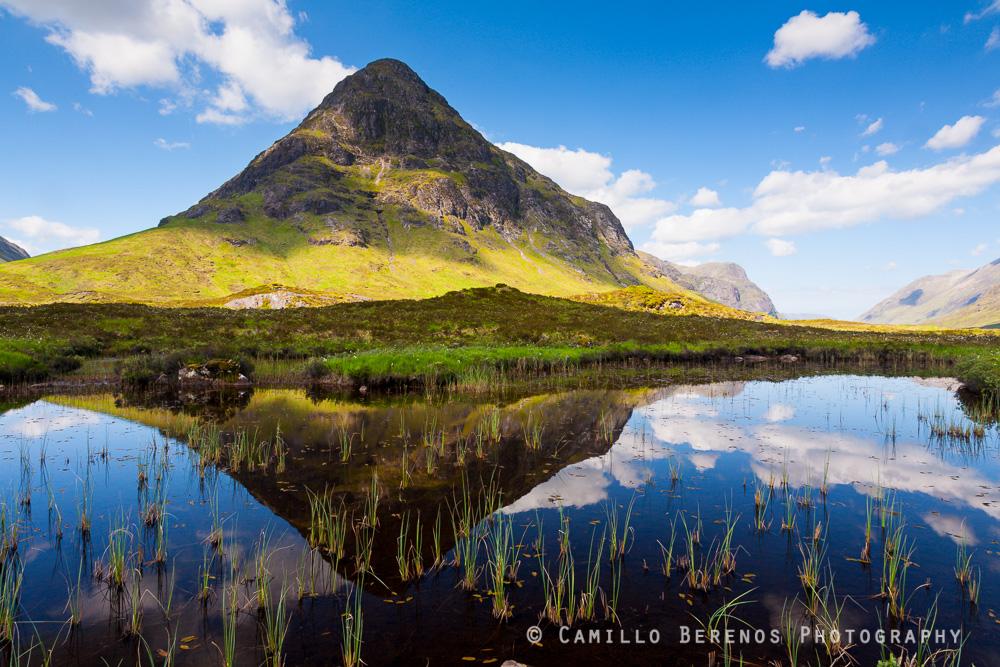 The Buachaille Etive Beag reflected in a lochan on a rare sunny day, near Glencoe