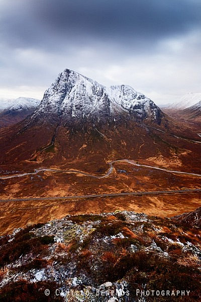 Looking down from Beinn a'Chrulaiste over the A82 with the Buachaille Etive Mor rising steeply above.