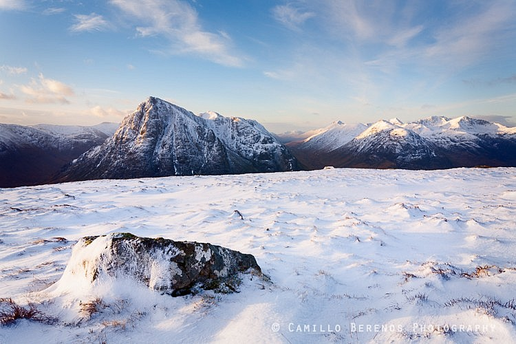 The skyline south-west of the A82 road to Glencoe in the subtle early morning winter light: Buachaille Etive Mor, Buachaille Etive Beag and Bidean Nam Bian