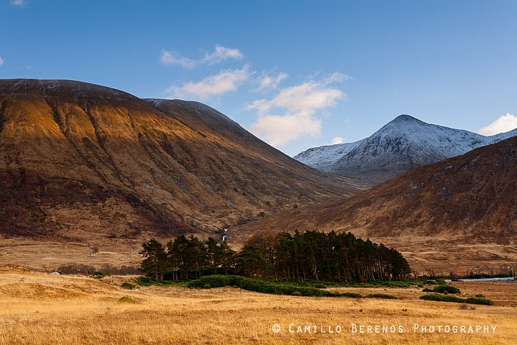 A stripe of light illuminating the mountains on the south side of Glen Etive