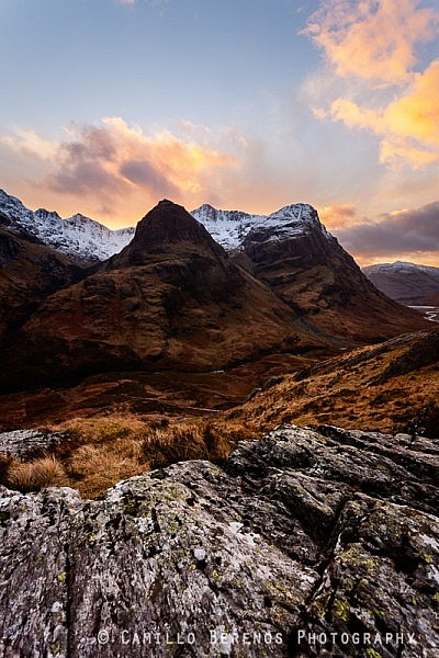 A winter sunset behind the Three Sisters, Glen Coe.