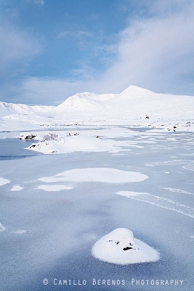 Meall A'Bhuiridh across a frozen Lochan na Stainge during the twilight hjours before sunrise
