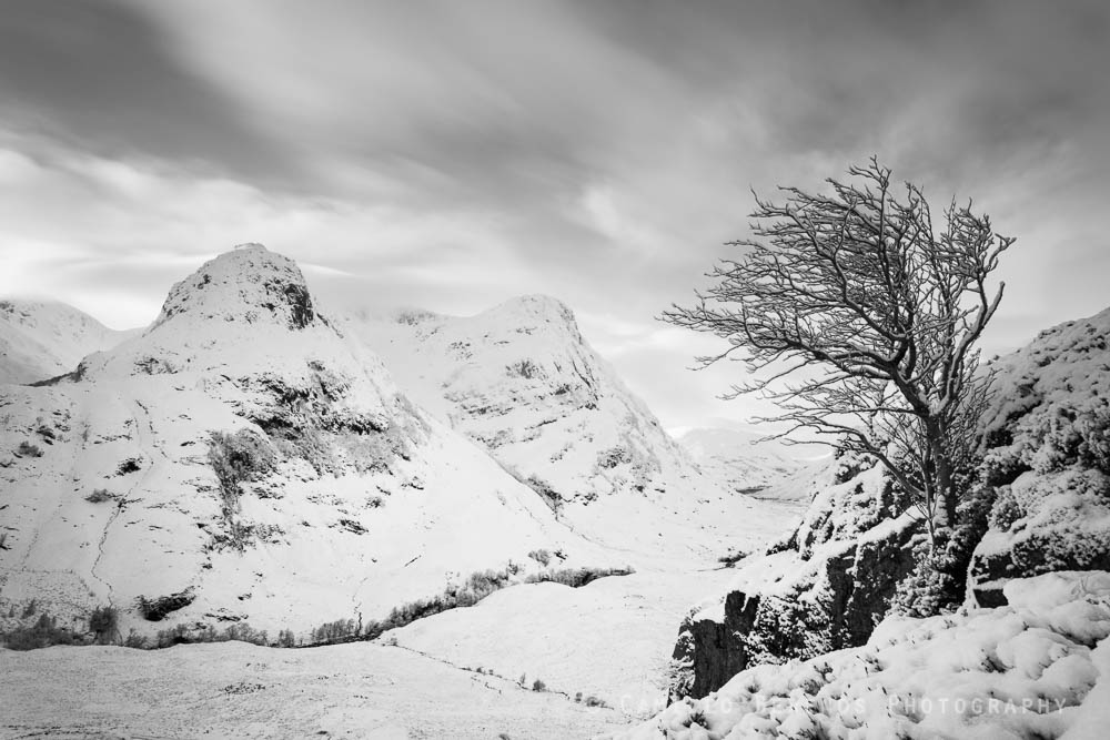 The steep climb through deep powdery snow was rewarded by this spectacular view over the Three Sisters of Glen Coe.