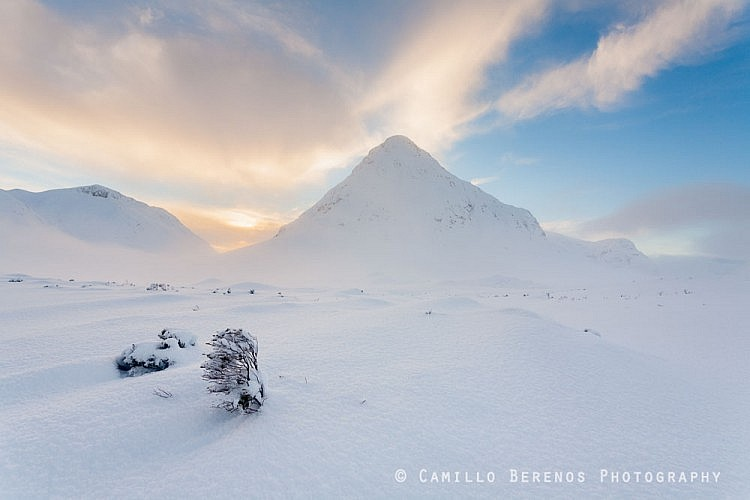Knee to chest-deep snow covering the bogs in front of the Buachaille Etive Beag at sunset.