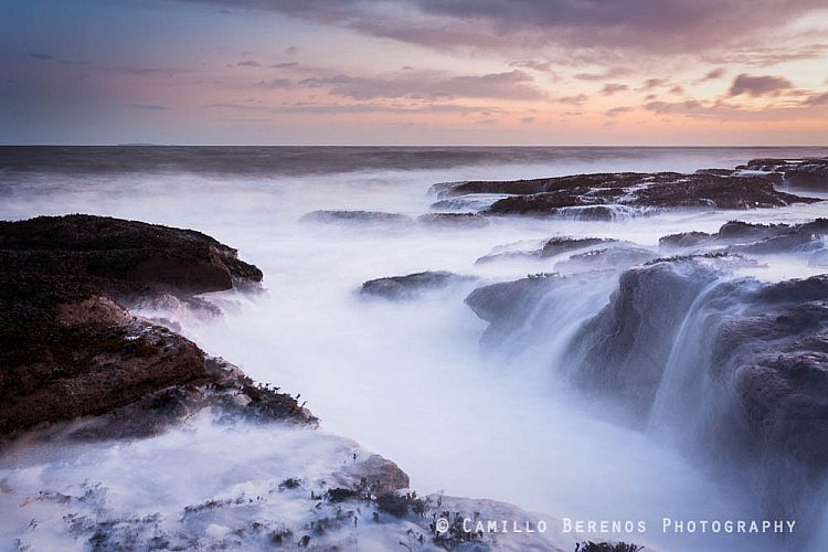 Large waves batter the rocky outcrops at Seacliff Beach