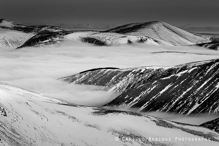 Inversion in the snowy hills of Dumfries and Galloway as seen from Lochcraig head.