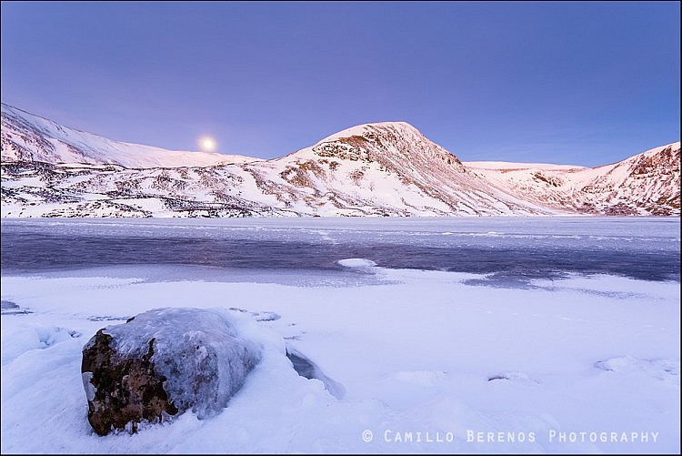 Loch Skeen (Dumfries and Galloway) at dawn with the moon about t set above the hills