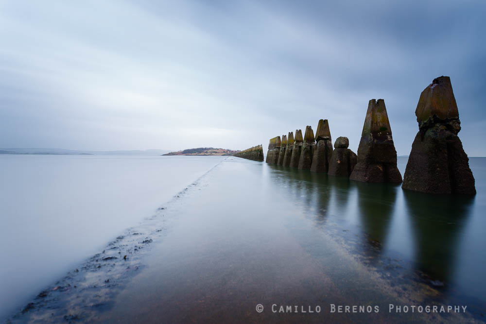 Moody long exposure of Cramond causeway starting to flood.