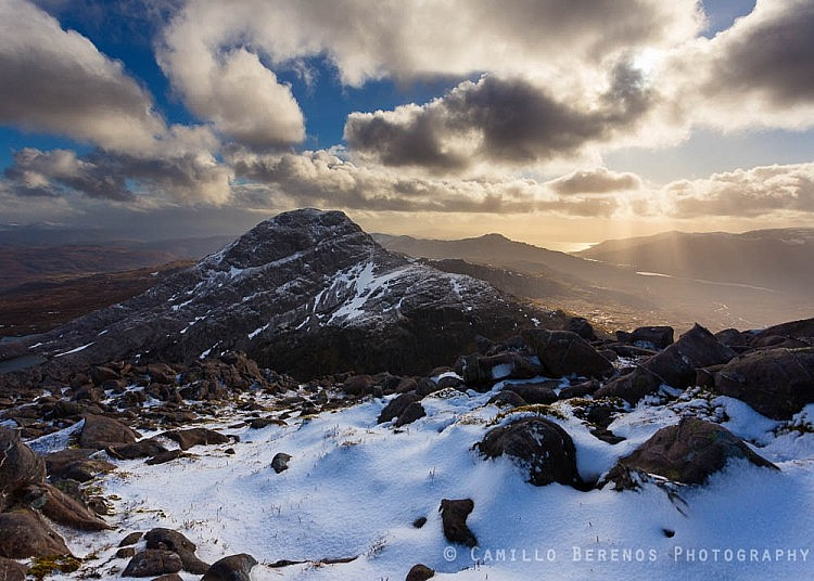 Crepescular rays behind a wintry An Ruadh-stac, Torridon