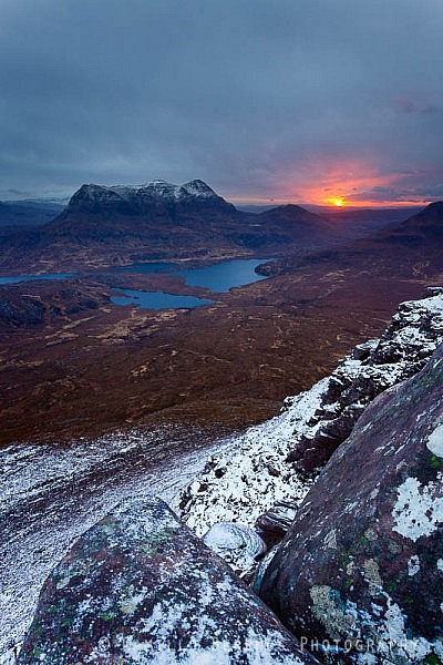 Cul Mor seen from the snow-covered slopes of Stac Pollaidh at sunrise