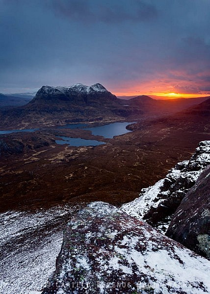 Sunrise behind Cul Mor seen from the summit of Stac Pollaidh