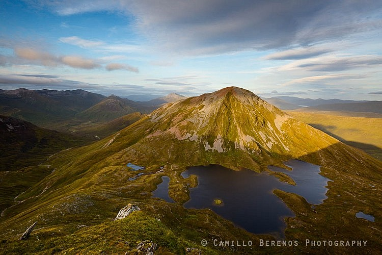 Sgurr Eilde Mor lit by the setting sun with the dramatic Coire an Lochain down below.