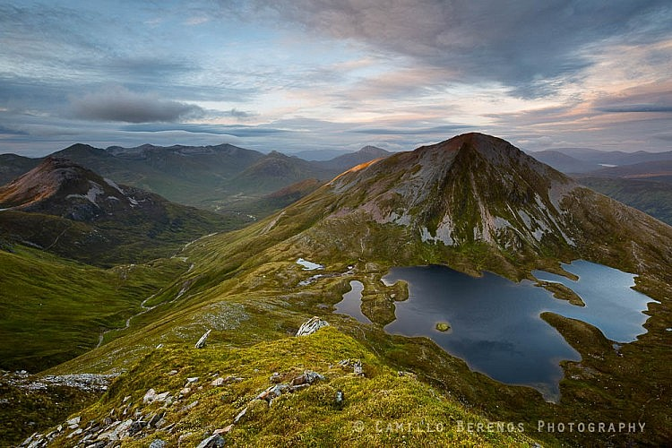 Binnein Beag (left) and Sgurr Eilde Mor as the setting sun pierces through the clouds.