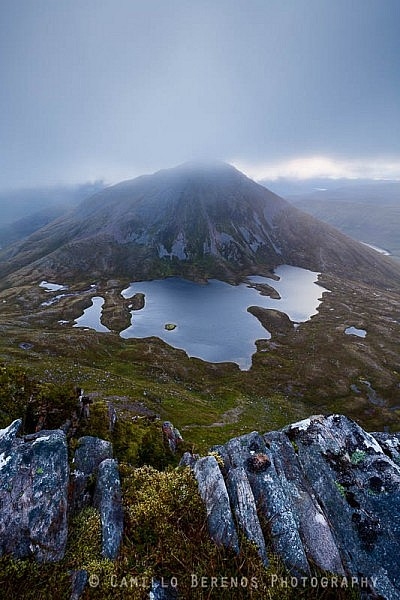 Sgurr Eilde Mor's summit partially shrouded by clouds at dawn