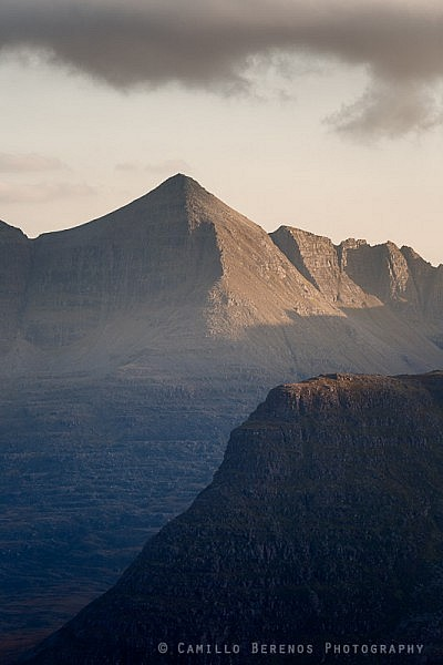 Spidean a' Choire Leith behind Carn na Feola sidelit by soft afternoon light