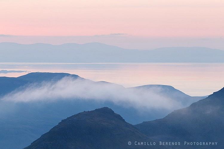 The Trotternish peninsula at dusk behind the ridges of Baosbheinn and Beinn Alligin