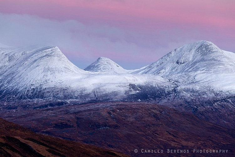 The snow-capped summits of Sgor Eilde Beag, Binnein Beag and Sgurr EIlde Mor at dawn