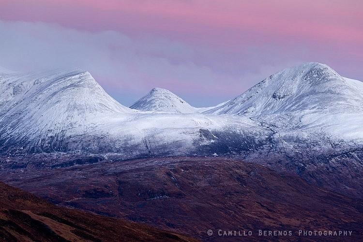 The snow-capped summits of Sgor Eilde Beag, Binnein Beag and Sgurr EIlde Mor at dawn