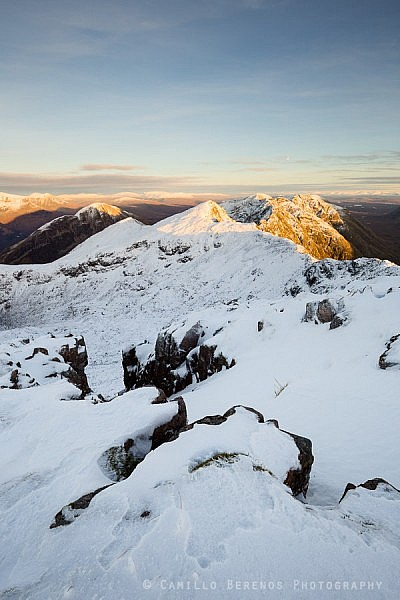 Late afternoon sidelight on the craggy ridge of the Aonach Eagach in winter