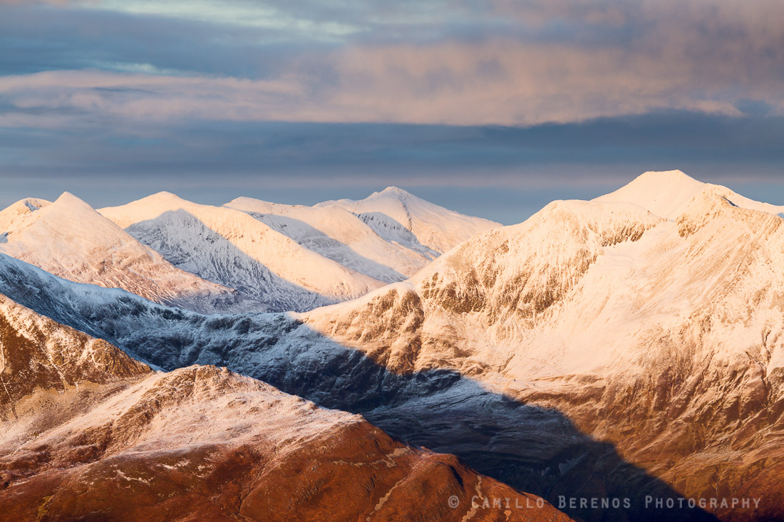 The snow-covered meandering ridge of the Mamore range