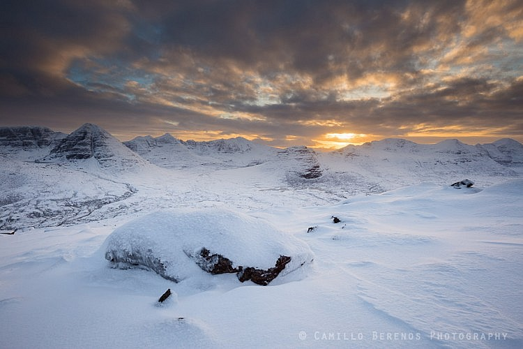 The impressively shaped snowy mountains of Torridon at sunset in winter