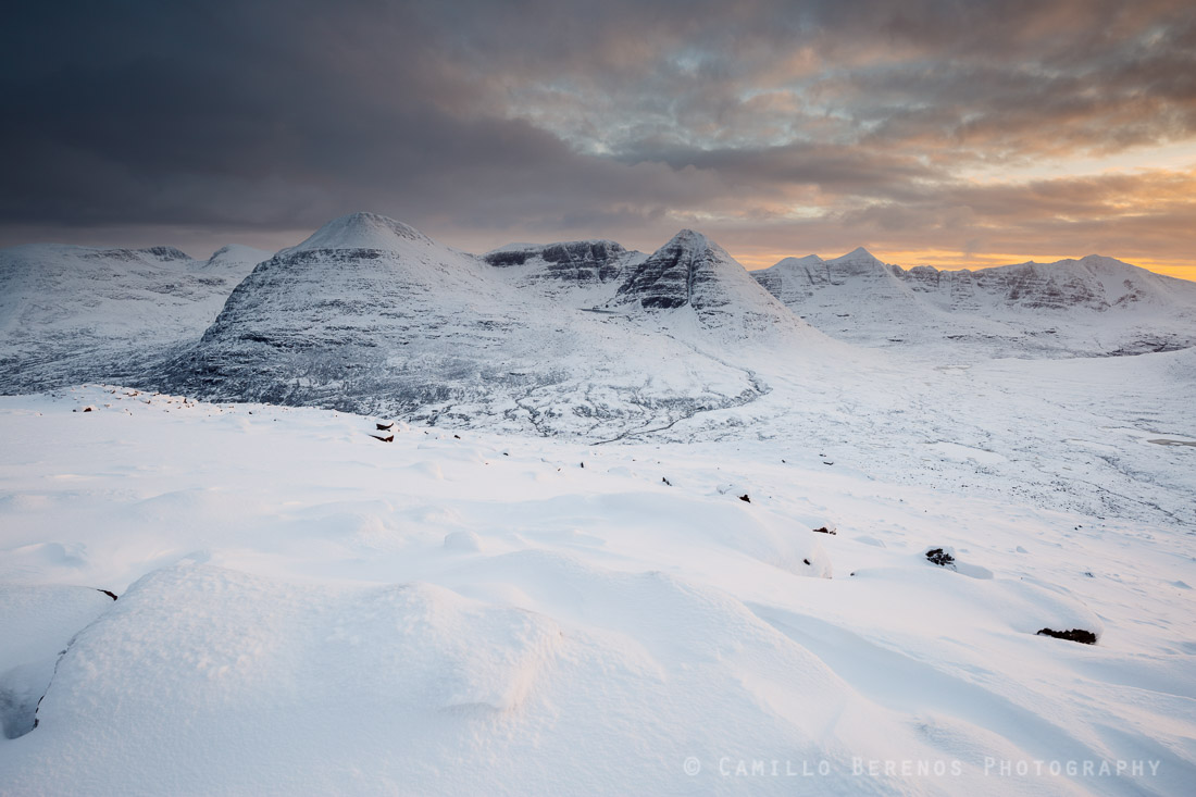 Beinn Eighe and Liathach under a thick snow cover at sunset