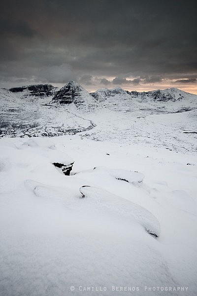 Wintry Beinn Eighe and Liathach seen after heavy snowfall at sunset