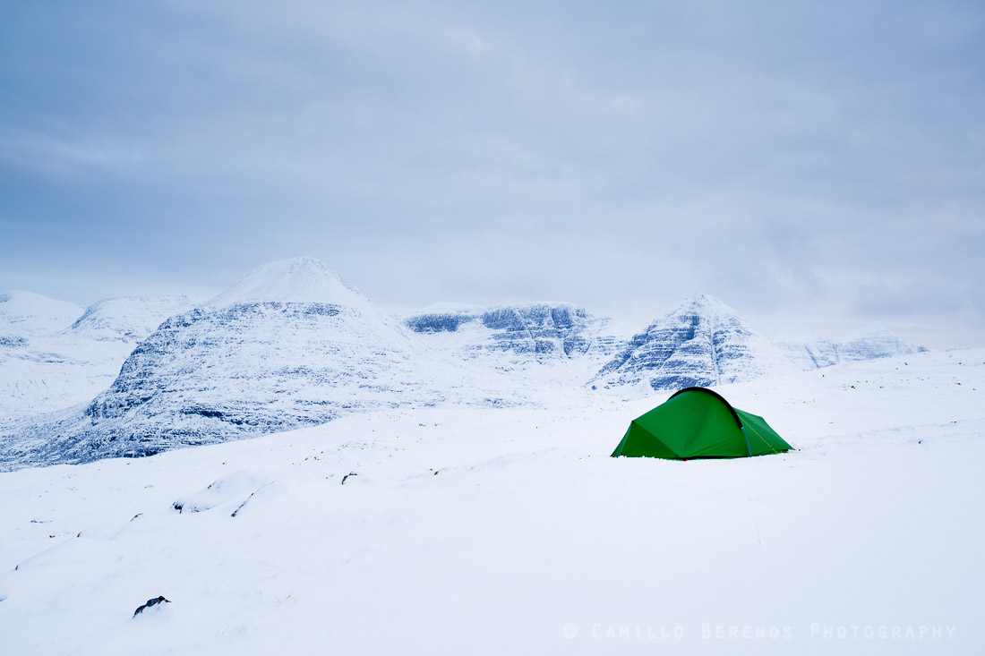 A tent pitched in the snow of the Torridon hills in winter