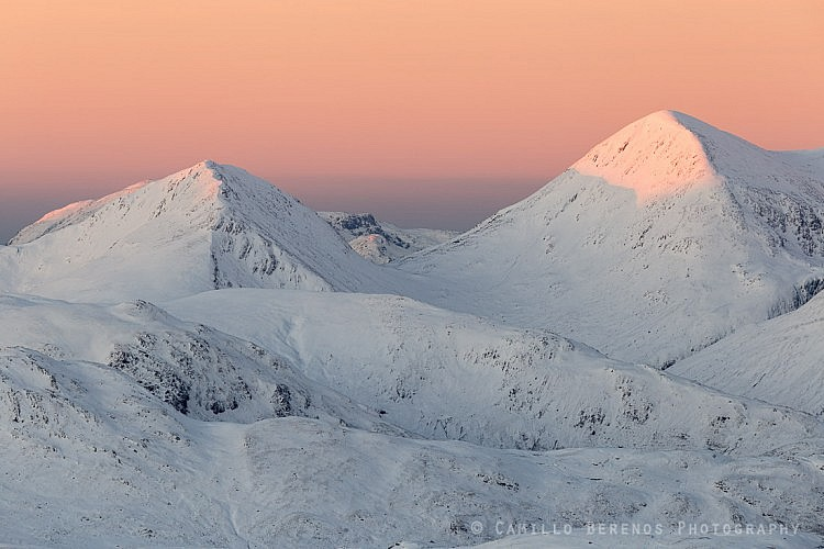 Alpenglow at sunrise on a snow-covered Beinn Sgritheall