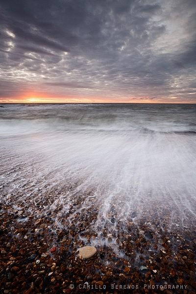 Blurred backwash at the shingle beach at Seaton Sluice, Northumberland