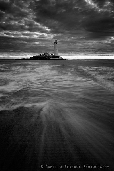 Waves crashing over the causeway to St Mary's lighthouse, Whitley bay
