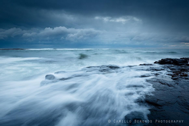 Large waves crash on the shores near Craster