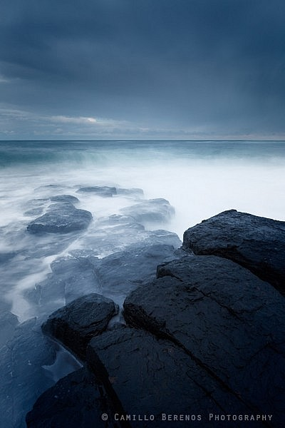 A stormy North Sea batters the rocky coast near Craster
