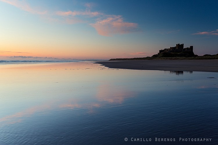 Some subtle pastle tones in the sky above Bamburgh castle, reflected on the wet beach