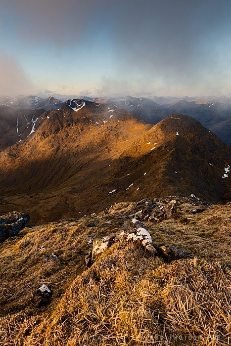 Sgurr na Carnach and Sgurr na Ciste Duibhe as seen from the frosty summit of Sgurr Fhuaran at sunrise
