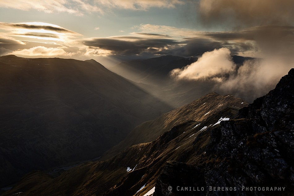 A sunbeam illuminating Gleann Lichd through the clouds over Beinn Fhada