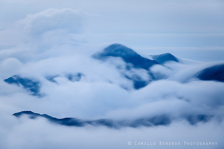 Sgurr Mor almost encapsulated by clouds and an inversion